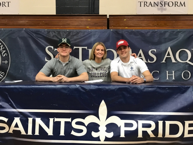 Three Saints Sign the Next Chapter of their Story