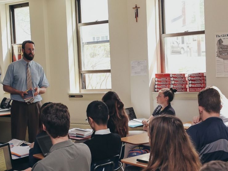 A teacher talking to a class at St. Thomas Aquinas High School in Dover, NH